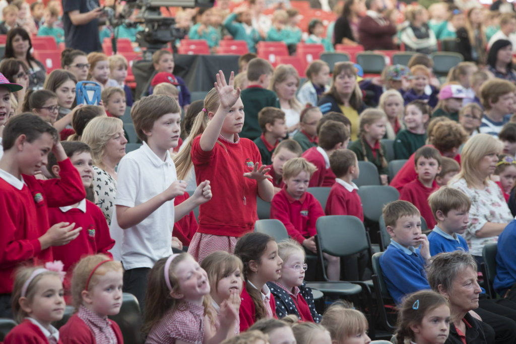 Llangollen International Musical Eisteddfod 2016. Schoolchildren enjoying the perfomances on stage during Children's Day